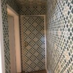 Hallway to basement finished in Henry Cole Wallpaper